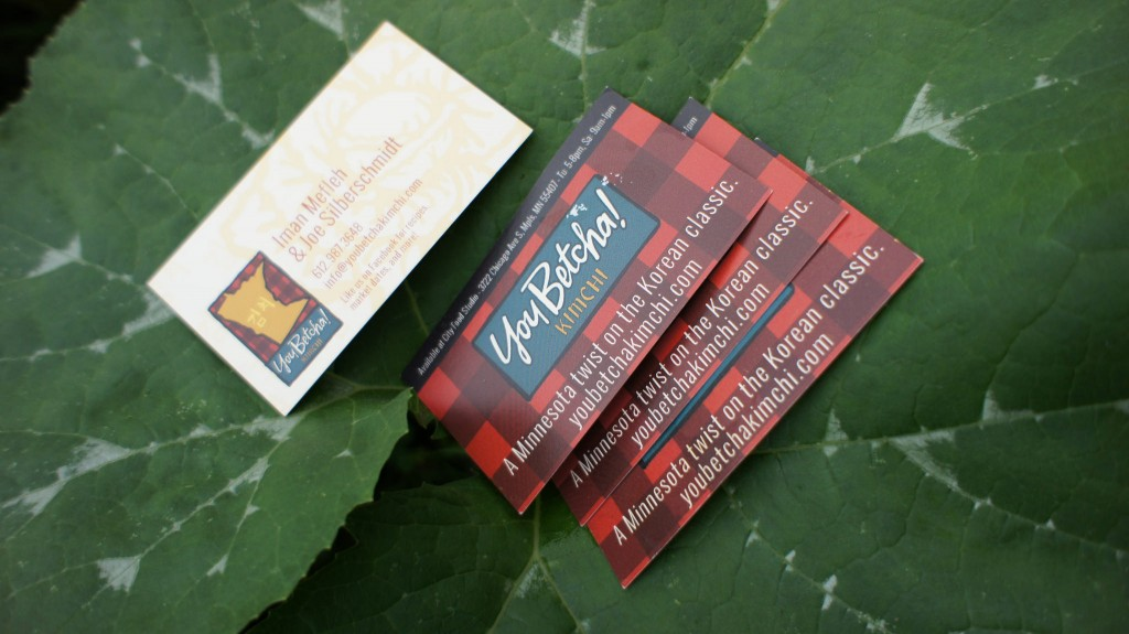You Betcha! Kimchi business cards resting on a large leaf.